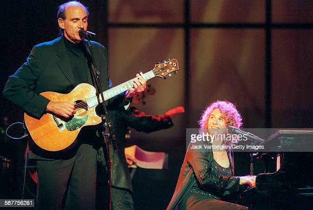 American Pop musicians James Taylor on guitar and Carole King on piano perform in the Theater at Madison Square Garden during People Magazine's 25th...