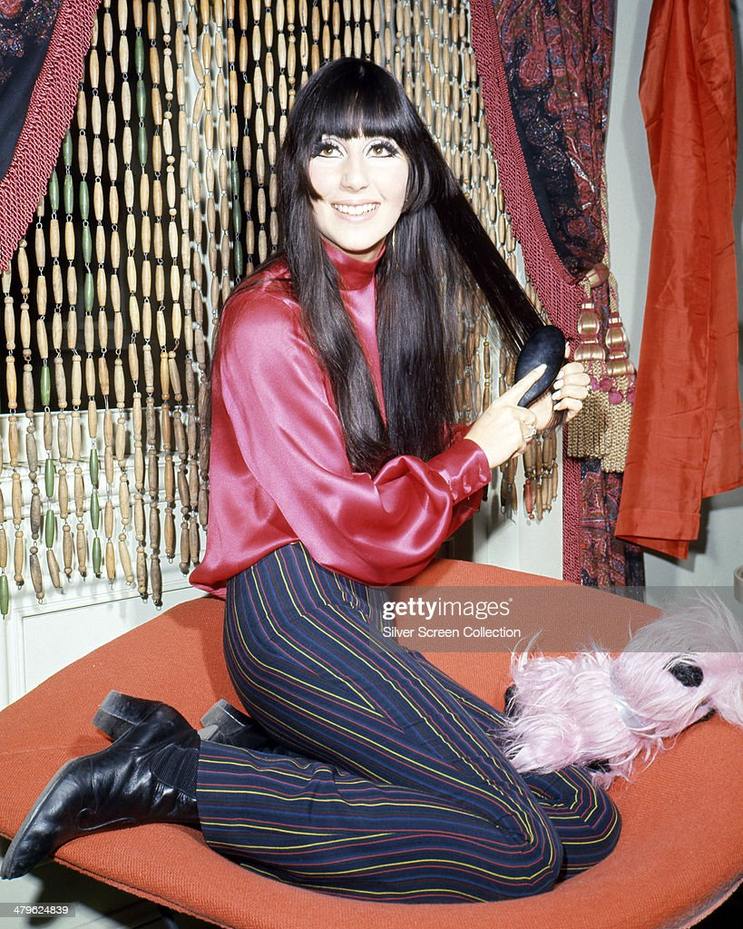American pop singer and actress Cher brushing her hair circa 1968