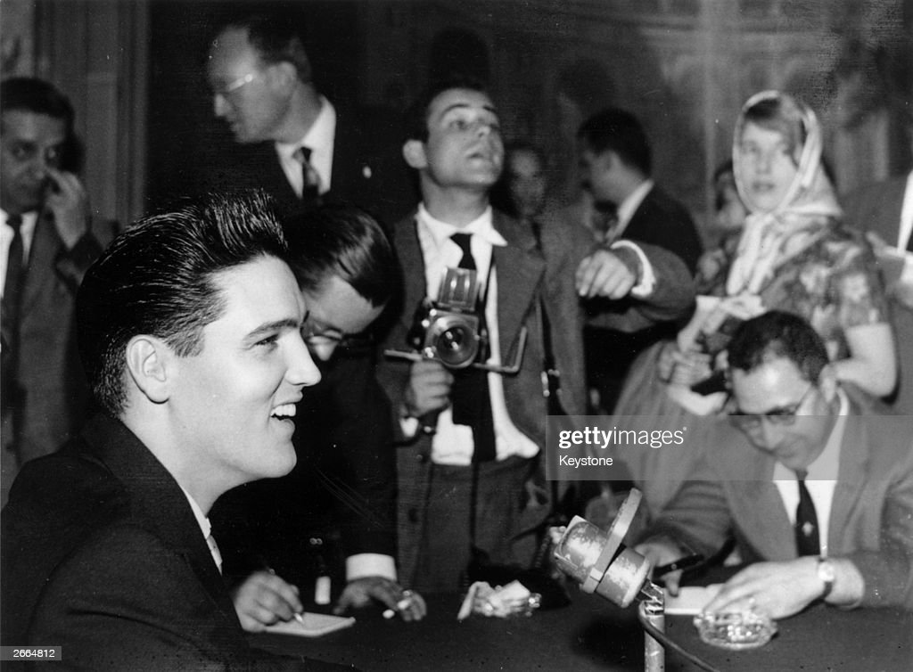 American pop singer Elvis Presley (1935 - 1977) at a press conference in Paris, where he is spending part of his leave from the American Forces, with whom he is serving in Germany.