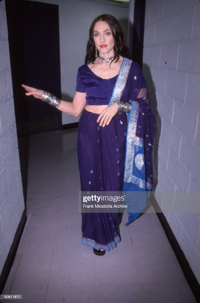 American pop singer <a gi-track='captionPersonalityLinkClicked' href=/galleries/search?phrase=Madonna+-+Singer&family=editorial&specificpeople=156408 ng-click='$event.stopPropagation()'>Madonna</a> backstage at the VH1 Fashion Awards, New York, New York, October 23, 1998.
