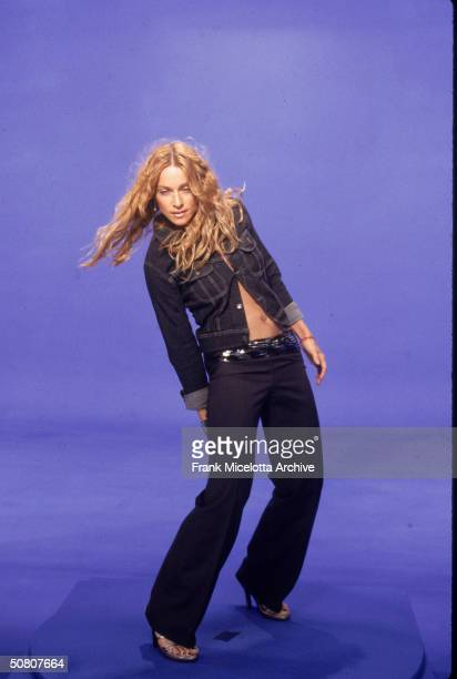 American pop singer Madonna dances in front of a blue screen during the video shoot for her single 'Ray Of Light' 1998