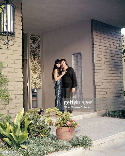 American pop singing duo Sonny Cher at the entrance to a house circa 1968 They are Cher and Sonny Bono