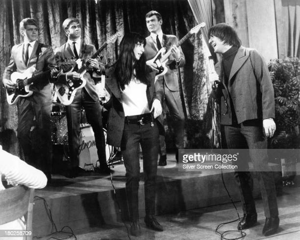 American pop singing duo Sonny Cher performing 'It's Gonna Rain' backed by surf group The Astronauts in 'Wild On The Beach' directed by Maury Dexter...