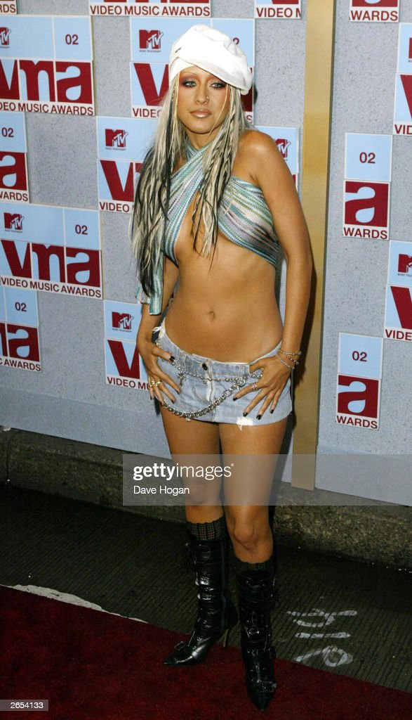 American pop star <a gi-track='captionPersonalityLinkClicked' href=/galleries/search?phrase=Christina+Aguilera&family=editorial&specificpeople=171272 ng-click='$event.stopPropagation()'>Christina Aguilera</a> arrives at the MTV Music Video Awards held at the Radio City Music Hall on August 29, 2002 in New York.