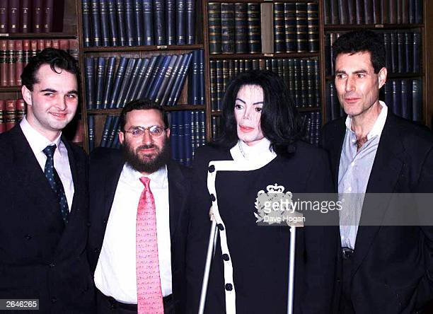 American pop star Michael Jackson Israeli paranormalist Uri Geller and Rabbi Schmuly Botesh arrive at the Oxford Union to speak in aid of the charity...