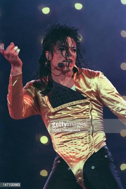 American pop star Michael Jackson performs at the Tokyo Dome Stadium December 12 1992 on the last leg of his 'Dangerous World Tour' AFP PHOTO TORU...