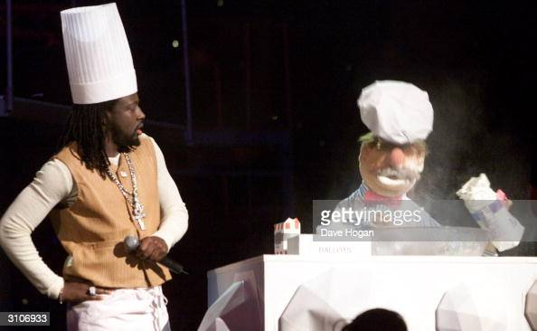 American pop star Wyclef Jean and the chef from the 'Muppets' perform on stage at the Europe MTV Music Awards on November 16 2000 in Stockholm Sweden