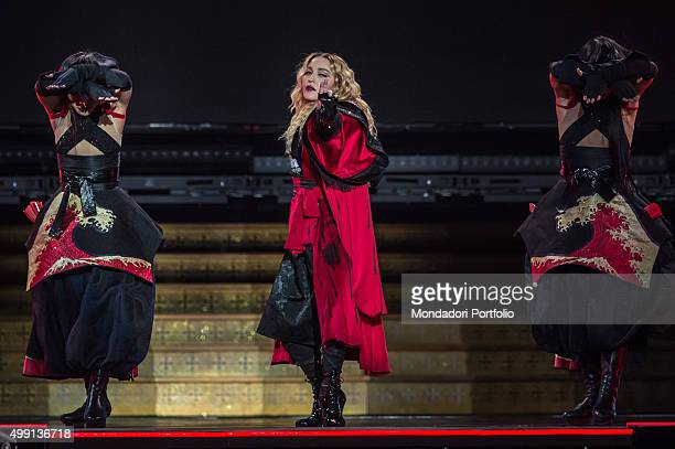 American popstar Madonna singing one of her songs and dancing with two Japanese dancers during her concert of 'Rebel Heart Tour' at PalaAlpitour...