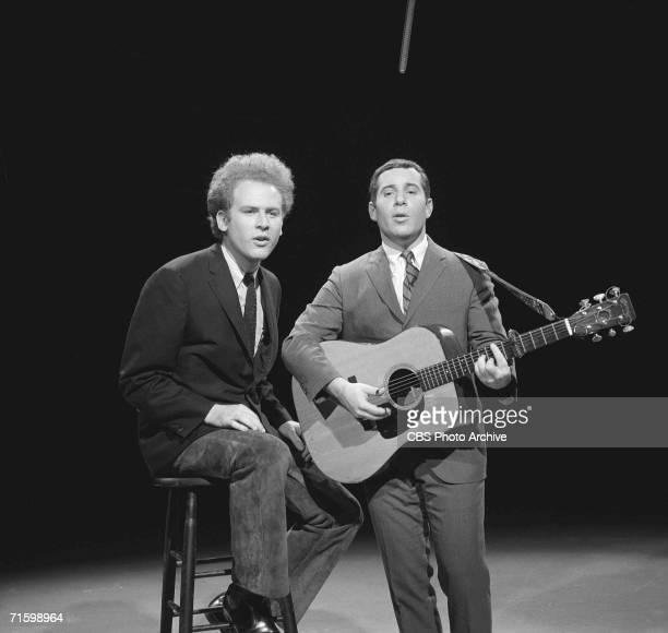 American popular music duo Simon and Garfunkel who are singer Art Garfunkel and guitarist and singer Paul Simon performs on the CBS variety program...
