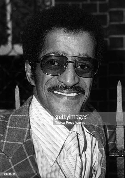 American popular singer and entertainer Sammy Davis Jnr displaying his customary broad grin