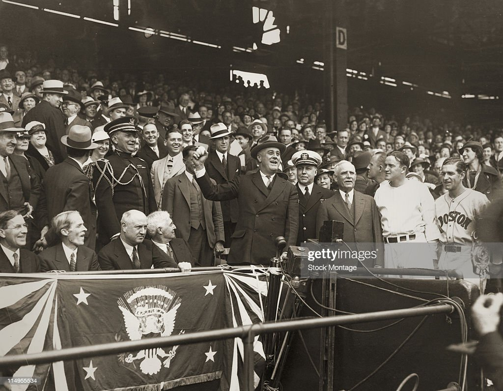 American President Franklin D. Roosevelt (1882 - 1945) prepares to throw out the first ball to open the baseball season before a game at Griffith Stadium, Washington DC, April 24, 1934. Among those pictured are, seated from second left, Presidential Secretary Marvin McIntyre (1878 - 1943), politican James Farley (1888 - 1976), and financier <a gi-track='captionPersonalityLinkClicked' href=/galleries/search?phrase=Bernard+Baruch&family=editorial&specificpeople=215235 ng-click='$event.stopPropagation()'>Bernard Baruch</a> (1870 - 1965), and, standing President Roosevelt, Captain Walter N. Vernon, baseball team owner and manager (and stadium namesake) Clark Griffith (1869 - 1955), and baseball player/managers <a gi-track='captionPersonalityLinkClicked' href=/galleries/search?phrase=Joe+Cronin&family=editorial&specificpeople=244129 ng-click='$event.stopPropagation()'>Joe Cronin</a> (1906 - 1984), and <a gi-track='captionPersonalityLinkClicked' href=/galleries/search?phrase=Bucky+Harris&family=editorial&specificpeople=216130 ng-click='$event.stopPropagation()'>Bucky Harris</a> (1896 - 1977). In the game, home team the Washington Senators lost to the Boston Red Sox.