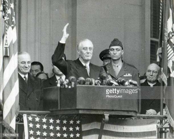 American President Franklin Delano Roosevelt waves from a lectern just after he took his 4th Oath of Office Washington DC January 20 1945 Among those...