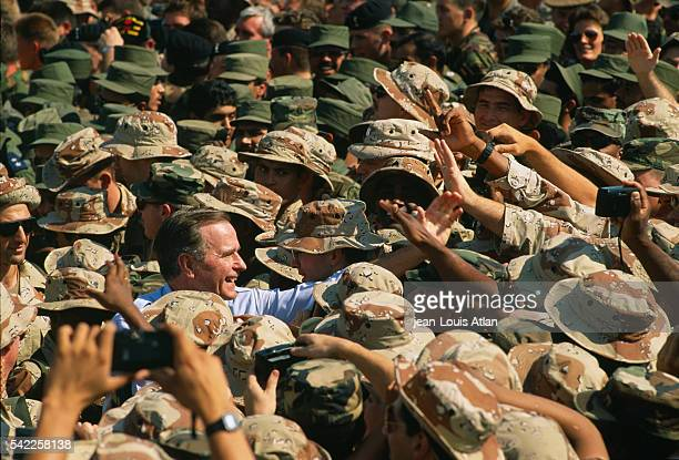 American President George Bush greets soldiers during his visit to US Troops stationed in Saudi Arabia during the Gulf war | Location Dharhan Saudi...