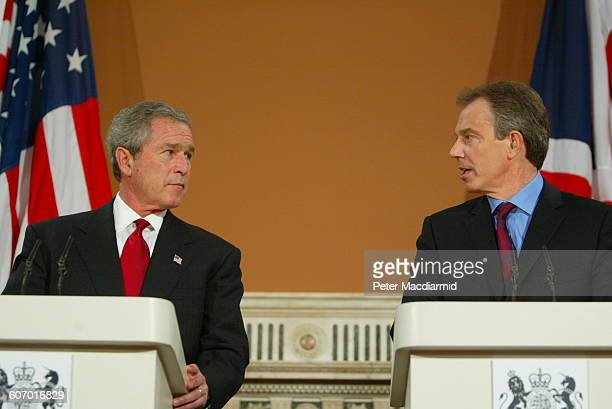 American President George W Bush and British Prime Minister Tony Blair speak during a press conference at the Foreign Office London England November...