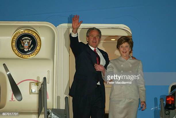 American President George W Bush and First Lady Laura Bush wave as they deplane from Air Force One at Heathrow Airport London England November 18 2003