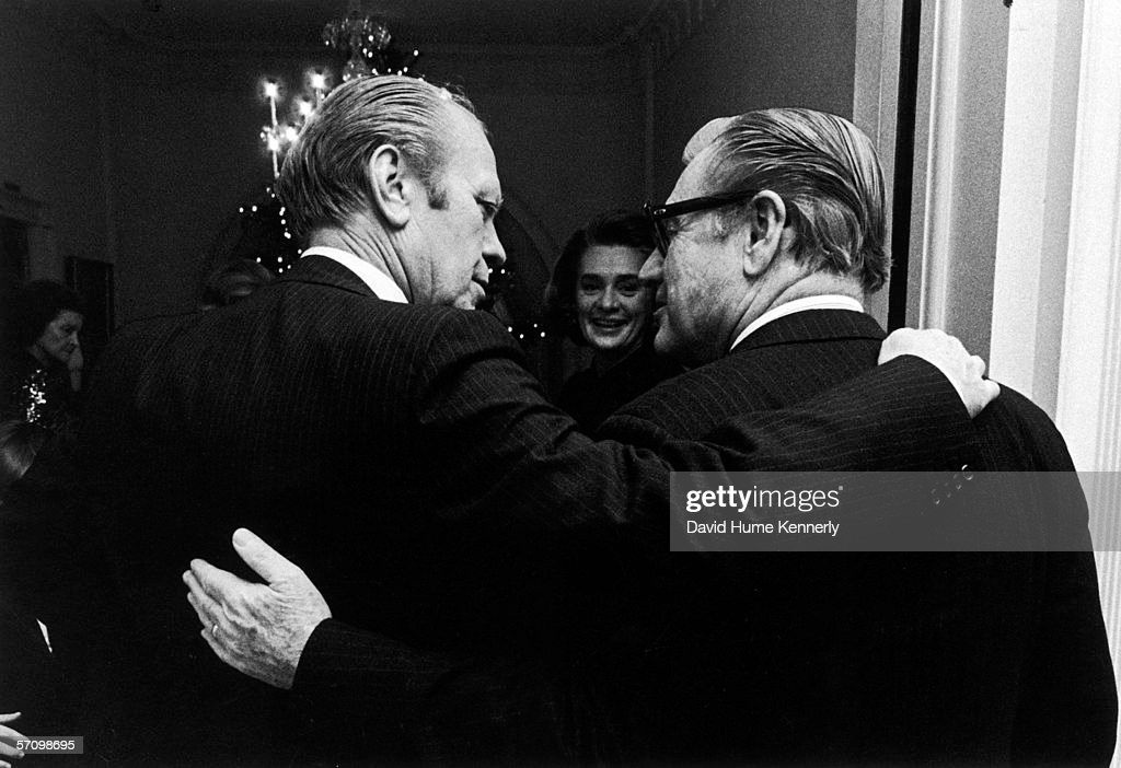 American President <a gi-track='captionPersonalityLinkClicked' href=/galleries/search?phrase=Gerald+Ford&family=editorial&specificpeople=125222 ng-click='$event.stopPropagation()'>Gerald Ford</a> (left) and his Vice President Nelson Rockefeller (1908 - 1979), both in pin stripe suits, stand arm in arm at the White House, December 12, 1974. Rockefeller's wife Margaretta (better known as Happy) is visible between them.