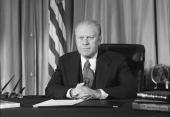 American president Gerald Ford appears on television from the Oval Office of the White House for a segment of the educational series 'Bicentennial...