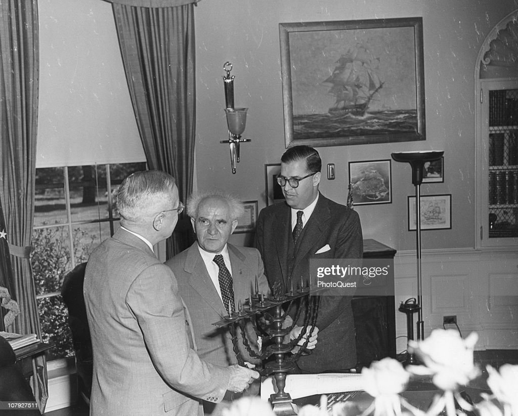 American President Harry S. Truman (1884 - 1972) (left) meets with Prime Minister David Ben-Gurion (1886 - 1973) (center) and Israeli Ambassador Abba Eban (1915 - 2002) who presented him with a menora at the White House, Washington DC, May 8, 1951.