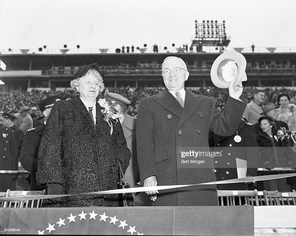 American President <a gi-track='captionPersonalityLinkClicked' href=/galleries/search?phrase=Harry+Truman&family=editorial&specificpeople=91039 ng-click='$event.stopPropagation()'>Harry Truman</a> (1884 - 1972) and his wife, First Lady <a gi-track='captionPersonalityLinkClicked' href=/galleries/search?phrase=Bess+Truman&family=editorial&specificpeople=93132 ng-click='$event.stopPropagation()'>Bess Truman</a> (1885 - 1982) greet the crowd before the start of the annual Army-Navy football game, in Municipal Stadium, Philadelphia, Pennsylvania, December 1, 1945.