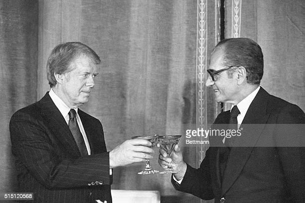 American President Jimmy Carter and Shah Reza Pahlavi of Iran toast following a formal dinner in the Niavaran Palace in Tehran Iran