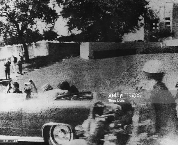 American president John F Kennedy is struck by an assassin's bullet as he travels through Dallas in a motorcade 22nd November 1963 In the car next to...