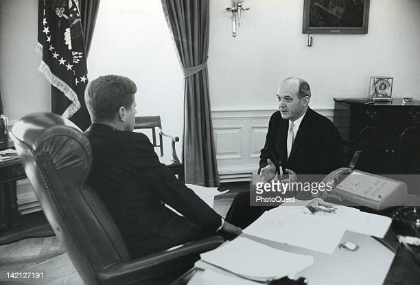 American President John F Kennedy talks to Secretary of State Dean Rusk in the White House's Oval Office Washington DC 1961