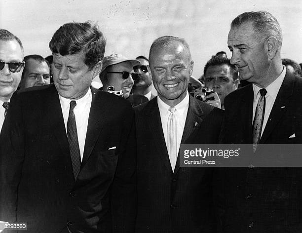 American President John F Kennedy talks with astronaut John Glenn and Vice President Lyndon Baines Johnson shortly after his arrival on Air Force One...