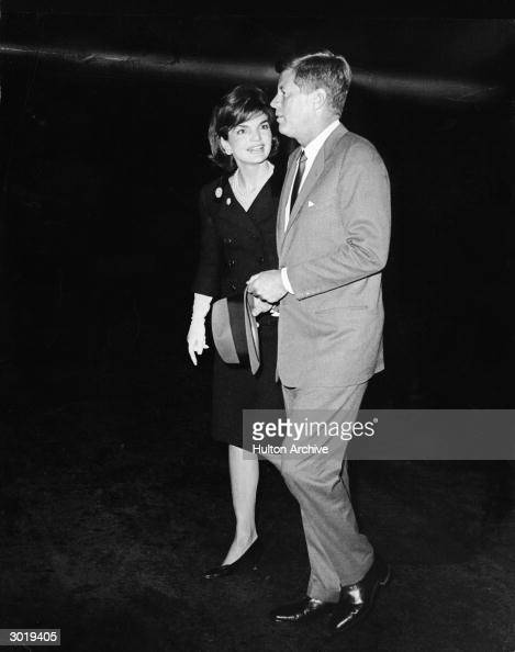 American President Kennedy and Mrs Jacqueline Kennedy walk away from the president's private plane in which Mrs Kennedy had returned after a visit to...
