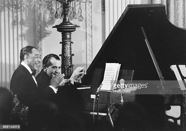 American President Richard M Nixon plays 'Happy Birthday' for guest Duke Ellington after a White House dinner in honor of Ellington's 70th birthday...