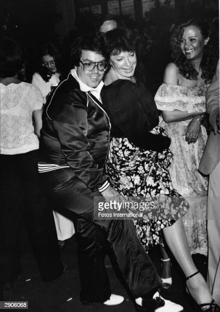 American producer Allan Carr dances at the party for the film 'Grease' directed by Randal Kleiser June 1978