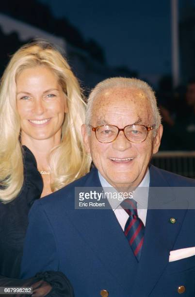 American producer Dino De Laurentiis and his wife Martha Schumacher attend the premiere of Jonathan Mostow's movie U571 during the Deauville Festival...