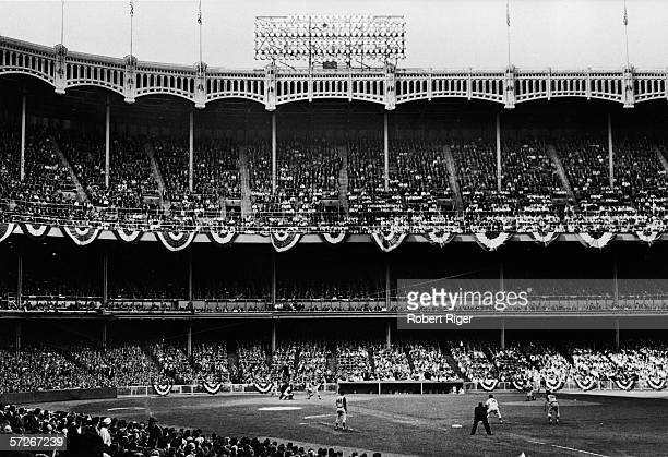 American professional baseball player Bill Skowron first baseman of the New York Yankees watches to see how a pitch turns out during a World Series...