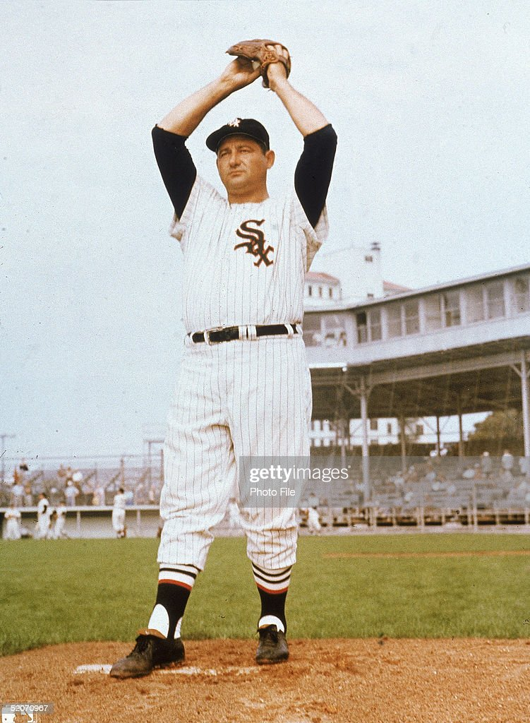American professional baseball player Early Wynn pitcher of the American League's Chicago White Sox stands on the pitcher's mound with his hands...