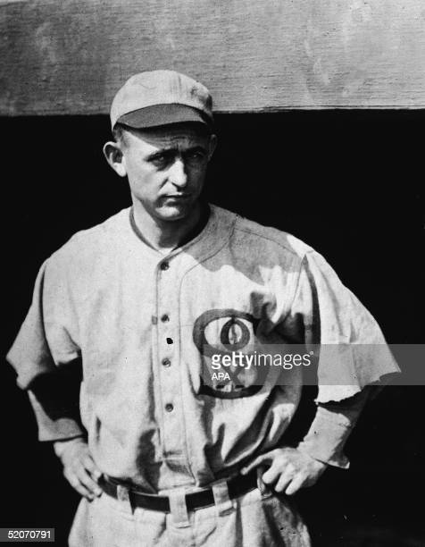 American professional baseball player pitcher Dickie Kerr of the American League's Chicago White Sox stands in a home uniform with arms akimbo...