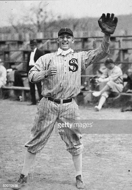 American professional baseball player third baseman Buck Weaver wears a baseball glove and appears ready to catch a baseball 1916 Weaver was banned...