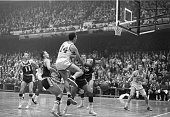American professional basketball player Bob Cousy leaps in the air during a play against the Los Angeles Lakers in a game at Boston Garden Boston...