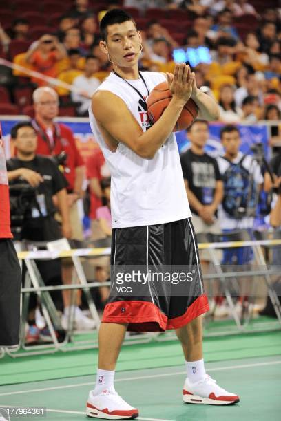 American professional basketball player Jeremy Lin of the Houston Rockets plays basketball with young kids at a Jeremy Lin Basketball Camp at...