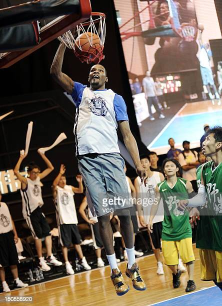 American professional basketball player Kevin Durant of the Oklahoma City Thunder attends a meeting with fans at Xi'an Jiaotong University on August...