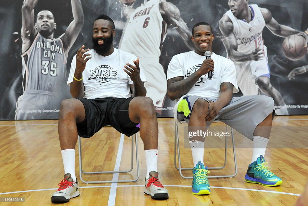 American professional basketball players <a gi-track='captionPersonalityLinkClicked' href=/galleries/search?phrase=James+Harden&family=editorial&specificpeople=4215938 ng-click='$event.stopPropagation()'>James Harden</a> (L) of Houston Rockets and <a gi-track='captionPersonalityLinkClicked' href=/galleries/search?phrase=Eric+Bledsoe&family=editorial&specificpeople=6480906 ng-click='$event.stopPropagation()'>Eric Bledsoe</a> of Los Angeles Clippers attend a training session of the 2013 Nike All-Asia Basketball Camp on June 10, 2013 in Guangzhou, China.