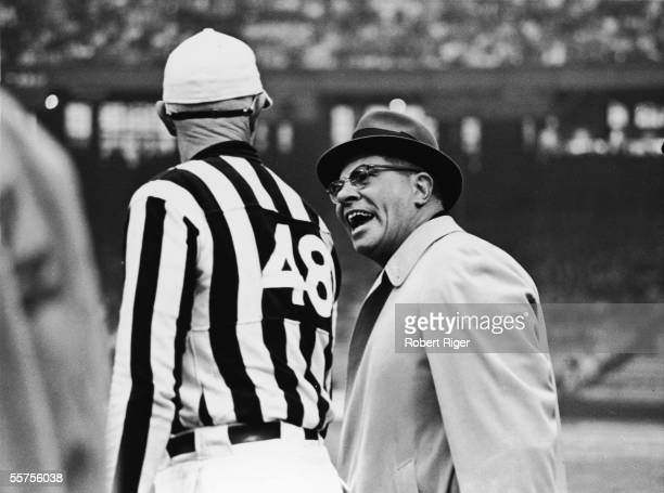 American professional football coach Vince Lombardi appears irritated while he confers with a referee during a game late 1950s to early 1960s...
