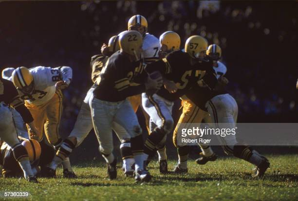 American professional football player Bobby Layne quarterback fo the Pittsburgh Steelers drops back to pass during a game against the Green Bay...