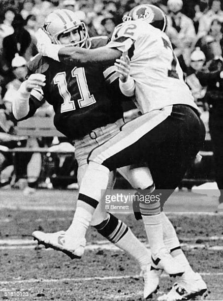 American professional football player Dexter Manley of the Washington Redskins sacks Dallas Cowboys quarterback Danny White during the second quarter...