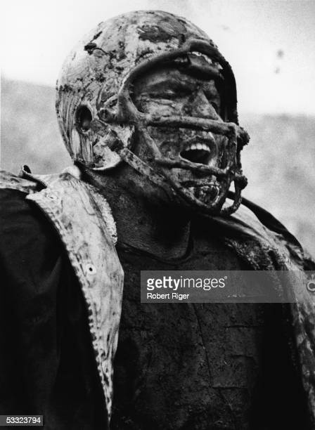 American professional football player Forrest Gregg of the Green Bay Packers lets out a victory roar from the sidelines while covered in mud during a...