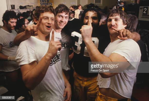 American professional football player Franco Harris of the Pittsburgh Steelers makes the 'number one'sign as he and teammates celebrate in the locker...