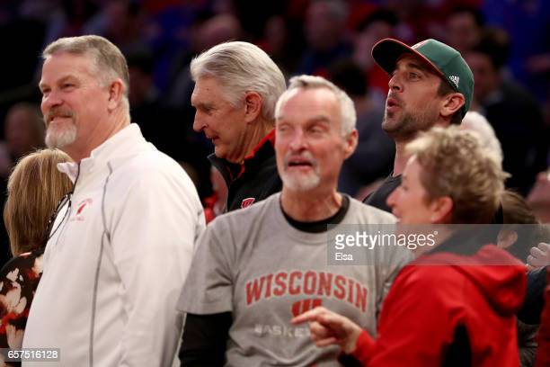 American Professional Golfer Andy North NFL Green Bay Packers quarterback Aaron Rodgers celebrates Zak Showalter of the Wisconsin Badgers three point...