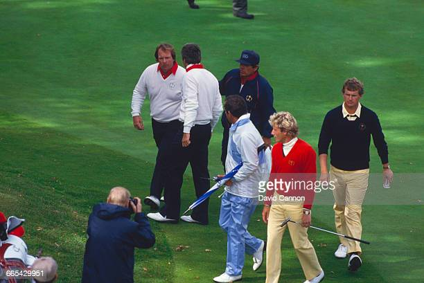 American professional golfer Craig Stadler is consoled by teammate Lee Trevino after missing a key 18inch putt at the 18th during the 1985 Ryder Cup...
