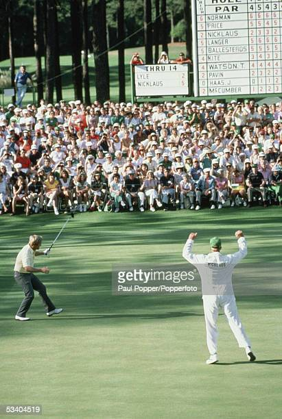 Jack Nicklaus of the USA celebrates with his son and caddie Jackie as he holes his putt at the 15th hole at the 1986 US Masters in April 1986 at the...