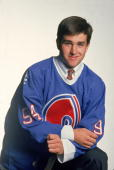 American professional hockey player Chris Drury poses for a portrait in a new team jersey after he was drafted by the Quebec Nordiques at the NHL...