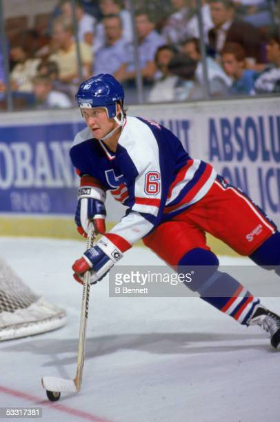 American professional hockey player Phil Housley of Team USA follows the puck around a goal post during the 1987 Canada Cup Canada 1987