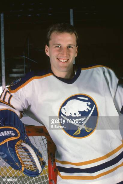 American professional hockey player Tom Barrasso goalie of the Buffalo Sabres poses as he leans on his goal during his rookie season 198384 Season